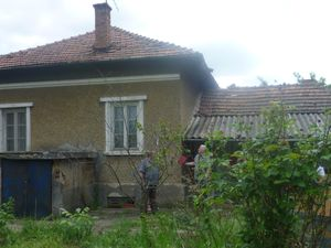 Old country house with big plot of land located in a village