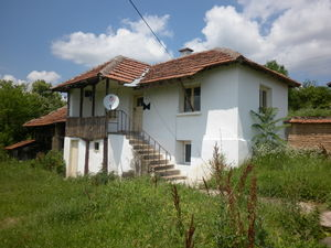 Old rural house with plot of land situated in quiet village