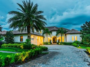 ONE OF A KIND LAKE AND GOLF FRONT CUSTOM HOME