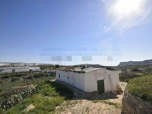 Detached property close to town.