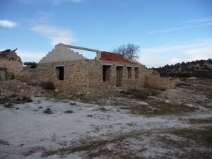 withTwo buildings on a large plot of land. JLCLLR03