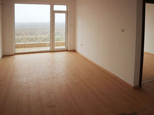 New, unfurnished apartment with open views to the fields