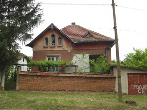 Rural house with garage & land in village close to main road