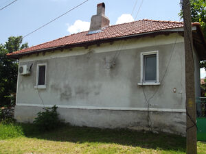 Partially renovated country house with land in big village