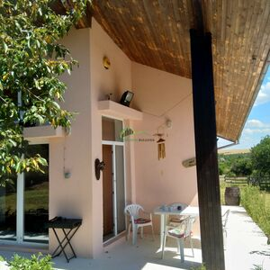 Fully-furnished house with a swimming pool and caravan