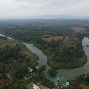 THAILAND Land for sale next to Nan river with mountain view